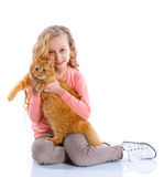 Girl with her cat Stock Image