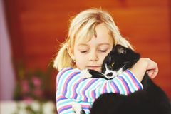 Girl with her cat Royalty Free Stock Photo