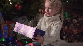 Girl with her Christmas Gift stock video footage