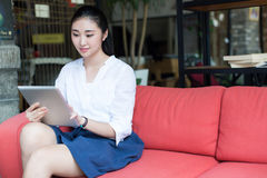 Girl and her computer tablet pcs Royalty Free Stock Image