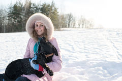 Girl with her cute dog Stock Images