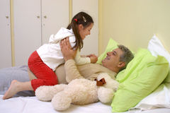 Girl with her daddy. Little girl playing with her daddy