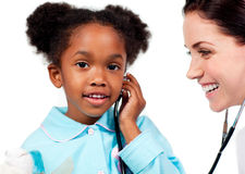 A girl and her doctor playing with a stethoscope Stock Photo