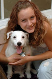 Girl and her dog. A pretty teen girl giving a squeeze to her dog royalty free stock photography