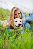 Girl with her dog. Resting outdoors Stock Images