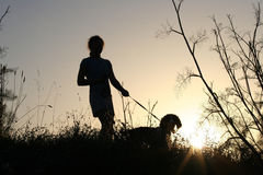 Girl and her dog. At sunset Stock Photo