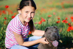 Girl and her dog Stock Image