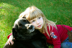 Girl and Her Dog 2. Little girl outdoors with her dog Stock Photography