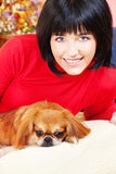 Girl and her dog Stock Images