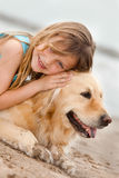 Girl with her dog. Portrait of a little girl with her dog outdoors Stock Photo