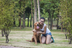 A girl with her dog Stock Photos