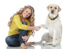 Girl with her dog. Portrait of happy girl with her dog isolated on white background Royalty Free Stock Photography