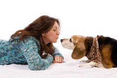 Girl and her dog. A fun scene of a girl and her friendly dog Royalty Free Stock Photography
