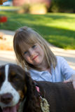 Girl and her dog. A four year old girl with her dog Royalty Free Stock Images