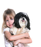 Girl and her dog. A four year old girl with her dog Stock Image