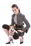 Girl and her dog. Pretty brunette kneeling with her jack russel against her knee Royalty Free Stock Photo