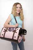 Girl and her dog. Girl holding her dog in her pink dog carrier Royalty Free Stock Images