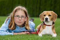 Girl and her dog. A girl and her dog lying on a meadow Royalty Free Stock Photos