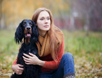 Girl and her dog  in the autumn park Royalty Free Stock Image