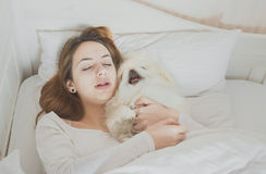 Girl and her dog in the bed. Beautiful girl and her dog in the bed stock photos