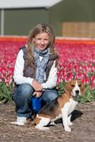 Girl with her dog on flower field Royalty Free Stock Images