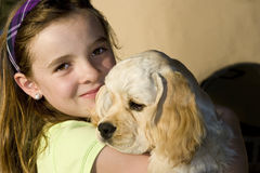 Girl and Her Dog II. A girl embracing her dog Royalty Free Stock Photos