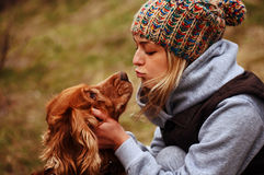 Girl with her dog Stock Image