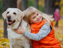 Girl with her dog labrador Royalty Free Stock Images
