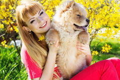 Girl with her dog on the nature Royalty Free Stock Image
