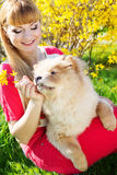 Girl with her dog on the nature Stock Images