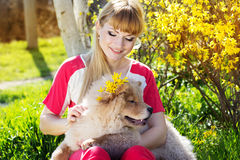 Girl with her dog on the nature Stock Photography