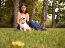 A girl with her dog. Nice afternoon in a park Stock Image