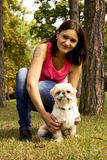 A girl and her dog. Nice afternoon in a park Stock Photos