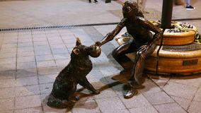 Girl With Her Dog Statue. Statue of a girl playing with her dog in Budapest Stock Images