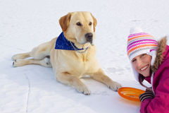 Girl with her dog in winter Stock Images