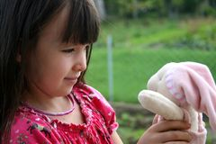Girl and her doll Royalty Free Stock Photography