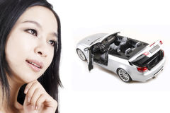 Girl with her dream car. Dream in the mind of beautiful girl Royalty Free Stock Photo