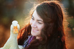 A girl and her duck Stock Photos