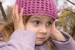 Girl  with her ears shut Royalty Free Stock Photo