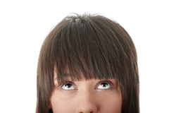Girl with her eyes looking away up Stock Photography