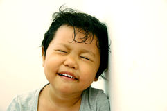 Girl with her eyes shut. Girl smiling with her eyes shut Royalty Free Stock Images