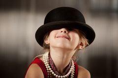 Girl with her face in her hat Royalty Free Stock Photos