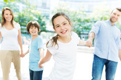 Girl with her family in the background Stock Photo