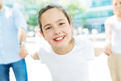Girl with her family in the background Stock Photography