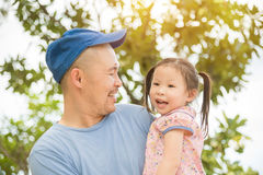 Girl with her father in the garden Royalty Free Stock Images