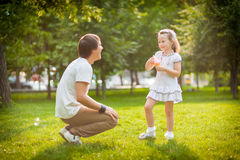 Girl with her father in the park Royalty Free Stock Photo