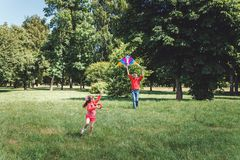The girl and her father play with a kite. Dad devotes time to the child royalty free stock photography