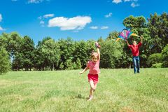 The girl and her father play with a kite. Royalty Free Stock Photo