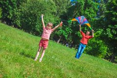 The girl and her father play with a kite. Royalty Free Stock Image