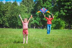 The girl and her father play with a kite. Royalty Free Stock Photography